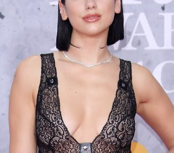 Dua Lipa Flashes Her Sexy Braless Cleavage And Ultra Sexy Legs